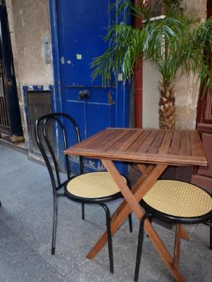 Blue door with palm tree Paris